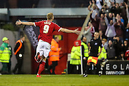 Michael Smith celebrates Swindon Towns 4th goal during the Sky Bet League 1 Play Off Second Leg match between Swindon Town and Sheffield Utd at the County Ground, Swindon, England on 11 May 2015. Photo by Shane Healey.