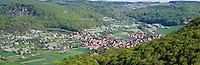 Forest covered hills of Veldensteiner forest surround village of Leutenbach in the Franconain Switzerland region of Bavaria, Germany