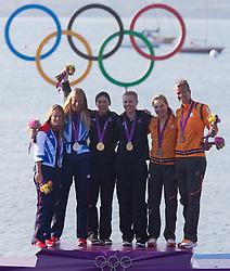10-08-2012 WATERSPORT: OLYMPISCHE SPELEN 2012 470 MEDALRACE: WEYMOUTH<br /> silver Medal Saskia Clark, Hannah Mills (GBR), Jo Aleh, gold Medal Olivia Powrie (NZL), Lobke Berkhout, bronze Medal Lisa Westerhof (NED) <br /> ***NETHERLANDS ONLY***<br /> ©2012-FotoHoogendoorn.nl