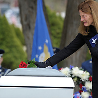 Sharon Wilkens places a rose on her son's casket during his burial ceremony Saturday at Pilot Butte Cemetery. 1st.  Lt. Justin James Wilkens, 26, was one of four members of the Air Force killed Feb. 28 when their small plane went down in Djibouti, Africa, where he was serving his third deployment with the 34th Special Operations Squadron.