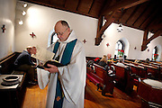 NORTH LAKE, WI — JANUARY 18, 2015:  Reverend David Couper prepares his verses before mass at St. Peter's Episcopal Church, Sunday, January 18, 2015.<br /> <br /> Ben Brewer for the New York Times
