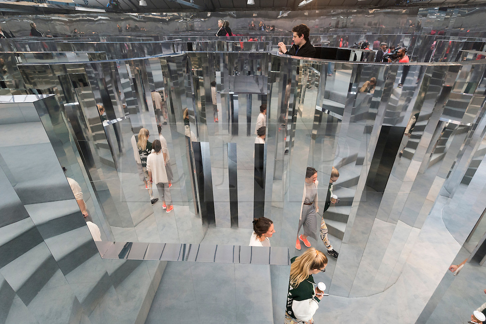 © Licensed to London News Pictures. 20/09/2016. Visitors views art installation titled Mirror Maze by set designer ES Devlin was commissioned by  The Fifth Sense, a partnership between Chanel and  i-D, conjures a complex imagined world played out over four rooms created in response to fragrance and exploring the way it can recall memories, time and places unsolicited.<br /> London, UK. Photo credit: Ray Tang/LNP