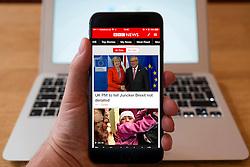 Using iPhone smartphone to display BBC News headlines on homepage