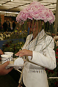 CINDY LASS ON KELWAY'S PEONY STAND, Press Preview of the RHS Chelsea Flower Show sponsored by Saga Insurance Services. Royal Hospital Rd. London. 22 May 2006. ONE TIME USE ONLY - DO NOT ARCHIVE  © Copyright Photograph by Dafydd Jones 66 Stockwell Park Rd. London SW9 0DA Tel 020 7733 0108 www.dafjones.com