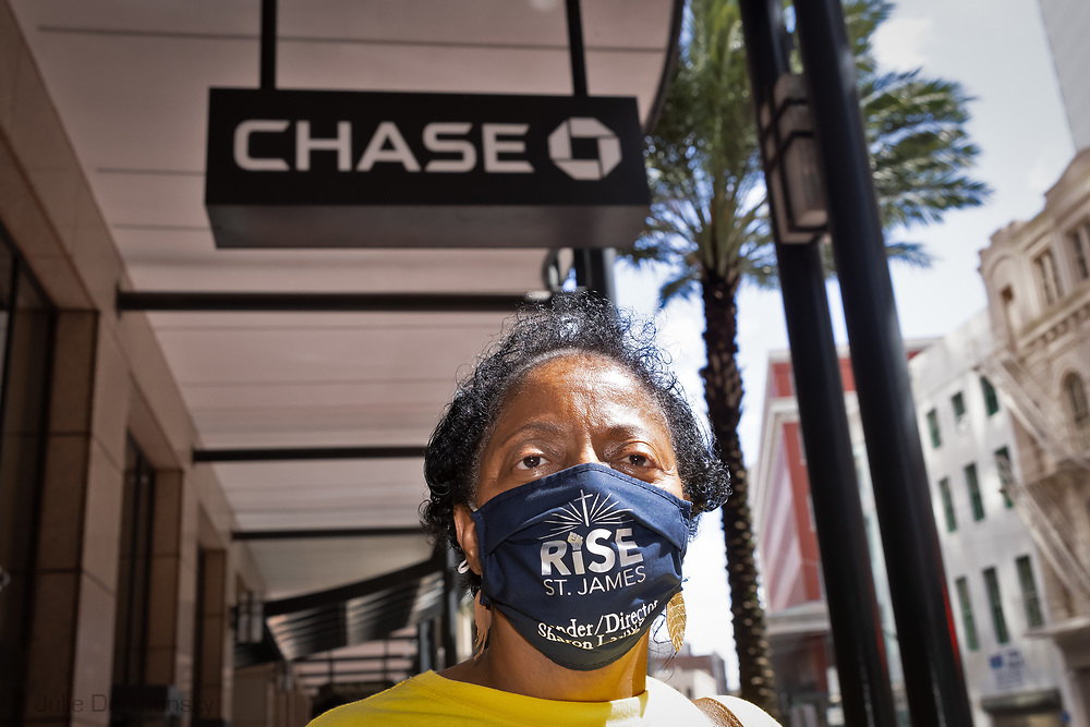 Sharon Lavinge, founder  of RISE St. James, attends a protest in front of a Chase Bank in New Orleans. Activists including Lavinge called on customers to close their Chase accounts due to the bank's investments in fossil fuel projects including its backing of Enbridge's Line 3 Pipeline project in Minnesota