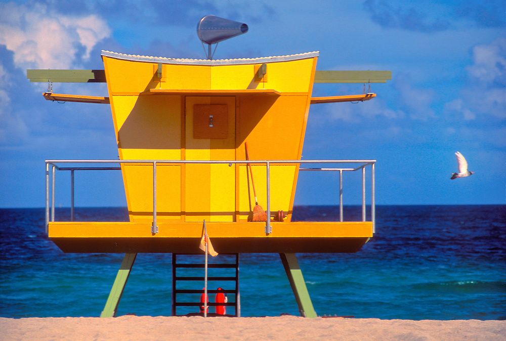 A seagull flies past a post-modern Miami Beach lifeguard stand designed by architect William Lane. <br /> <br /> A series of imaginative lifeguard stands -- each different -- that Lane designed in 1993 were inspired by South Beach's Deco, modernist and pop art heritage, and became instant and beloved local landmarks. <br /> <br /> Lane said this llttle building was inspired by the shape of vintage Art Deco table radios.