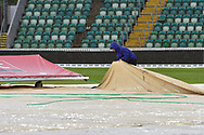Rain Stops Play - Groundstaff adjusting the covers as the heavy rain continues to fall during the Specsavers County Champ Div 1 match between Somerset County Cricket Club and Essex County Cricket Club at the Cooper Associates County Ground, Taunton, United Kingdom on 23 September 2019.
