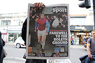 a Newspaper seller holds up a Standard Newspaper outside station before k.o. scenes around the Boleyn Ground, Upton Park in East London as West Ham United play their last ever game at the famous ground before their move to the Olympic Stadium next season. Barclays Premier league match, West Ham Utd v Man Utd at the Boleyn Ground in London on Tuesday 10th May 2016.<br /> pic by John Patrick Fletcher, Andrew Orchard sports photography.