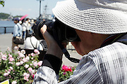 flower garden with person making pictures Japan