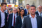 Businesswoman and campaigner Gina Miller, C who has launched legal proceedings against Prime Minister Boris Johnsons government over the suspension of parliament leaves  the Supreme Court with her legal team, surrounded by her personal security on the final day of the hearing on 19th September 2019 in London, United Kingdom. Supreme Court judges will decide if Prime Minister Boris Johnson acted unlawfully in advising the Queen to prorogue parliament.