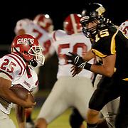 Jacksonville's Jermaine Linton rushes against Topsail's Walker Haley.