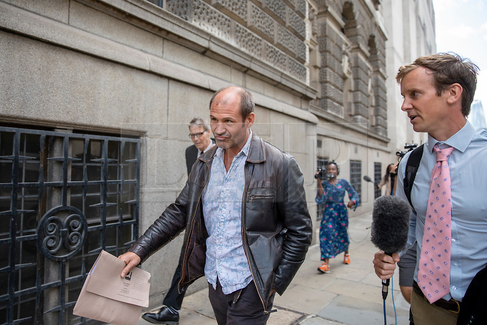 © Licensed to London News Pictures. 31/07/2018. London, UK. Former British soldier James Matthews (centre) leaves the Old Bailey after terror charges against him for fighting with a Kurdish militia group against ISIS were dropped. Photo credit: Rob Pinney/LNP