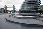 More London looking towards City Hall and Tower Bridge, which is normally bustling with tourists is eerily quiet and silent on empty streets as lockdown continues and people observe the stay at home message in the capital on 11th May 2020 in London, England, United Kingdom. Coronavirus or Covid-19 is a new respiratory illness that has not previously been seen in humans. While much or Europe has been placed into lockdown, the UK government has now announced a slight relaxation of the stringent rules as part of their long term strategy, and in particular social distancing.
