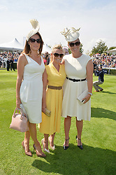 Left to right, NATALIE PINKHAM, GEORGIE THOMPSON and ZARA TINDALL at the 2014 Glorious Goodwood Racing Festival at Goodwood racecourse, West Sussex on 31st July 2014.
