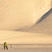 Forrest Jillson skis a sunrise line in the Teton backcountry.