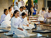 31 DECEMBER 2018 - BANGKOK, THAILAND: Women meditate during New Year's Eve prayers and meditation at Wat Pathum Wanaram in central Bangkok. Many Thais go to temples to meditate and pray on New Year's Eve.    PHOTO BY JACK KURTZ