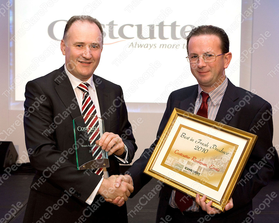 Jim Barry MD Barrys Group presents Tom Liddy of Costcutter Roslevan, Ennis with an award for 'Best In Fresh Produce 2010' at the Costcutters Awards banquet Dinner at the Ritz Carlton.<br /> Photo: Peter Houlihan / PH Photography