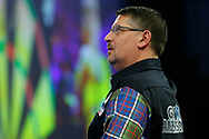 With one eye on the potential semi-final against Michael van Gerwen, Gary Anderson checks the scoreboard during the World Darts Championships 2018 at Alexandra Palace, London, United Kingdom on 29 December 2018.