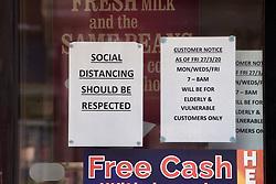 Social distancing sign in window of local food shop in Swanage during Coronavirus lockdown, Dorset UK April 2020
