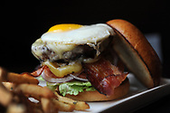 """The Local's hamburger, complete with fried egg. Wellesley resident Frank Santo recently opened his third location of """"The Local"""" restaurant, on Forest St. in Wellesley, Feb. 3, 2014.<br /> Wicked Local staff photo/Kate Flock"""