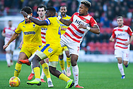 Mallik Wilks of Doncaster Rovers (7) tries to the steal the ball from Adedeji Oshilaja of AFC Wimbledon (4) during the EFL Sky Bet League 1 match between Doncaster Rovers and AFC Wimbledon at the Keepmoat Stadium, Doncaster, England on 17 November 2018.