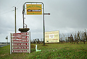 A road crossing in Bourgueil with many road signs indicating where the different wineries are: Samson, Caslot, Pierre Breton, Manoir de Brulon, Fleury Pere et Fils, Domaine de la Chevalerie. In winter., Bourgueil Indre et Loire France