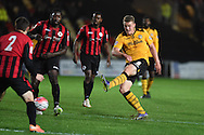 Yan Klukowski of Newport county ® has a shot at goal.  Emirates FA Cup 1st round replay match, Newport county v Brackley Town at Rodney Parade in Newport, South Wales onTuesday 17th November 2015. pic by Andrew Orchard, Andrew Orchard sports photography.