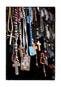 SHOT 2/6/15 11:58:14 AM - A row of rosary beads hang on a roadside capilla in the mountains just outside of Mascota, Mexico. The rosary beads provide a physical method of keeping count of the number of Hail Marys said as the mysteries are contemplated. The fingers are moved along the beads as the prayers are recited. By not having to keep track of the count mentally, the mind is free to meditate on the mysteries. Roadside capillas, or tiny chapels, are common along the roads and highways of Mexico which is heavily Catholic and are often dedicated to certain patron saints or to the memory of a loved one that has passed away. Often times they contain prayer candles, pictures, personal artifacts or notes. (Photo by Marc Piscotty / © 2015)