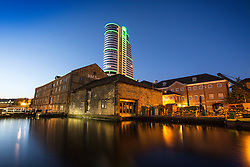 © Licensed to London News Pictures. 28/08/2015. Leeds, UK. Picture shows Leeds talest building Bridge Water Place at first light on what is set to be another bright day in Yorkshire. Whilst the UK is expecting unsettled weather over the bank holiday weekend Yorkshire is experiencing clear skies & bright sunshine. Photo credit: Andrew McCaren/LNP
