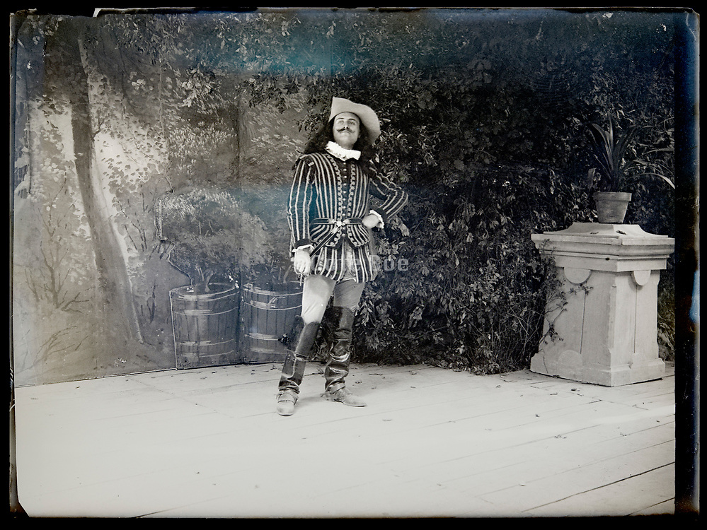 man dressed in historical clothing standing on a theater stage France circa 1930s