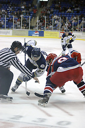 11 November 2006: Jon Booras (27) and Erick Anderson square off for a face off.&#xD;The Elmira Jackals met the Bloomington PrairieThunder at the U.S. Cellular Coliseum in Bloomington Illinois.<br />