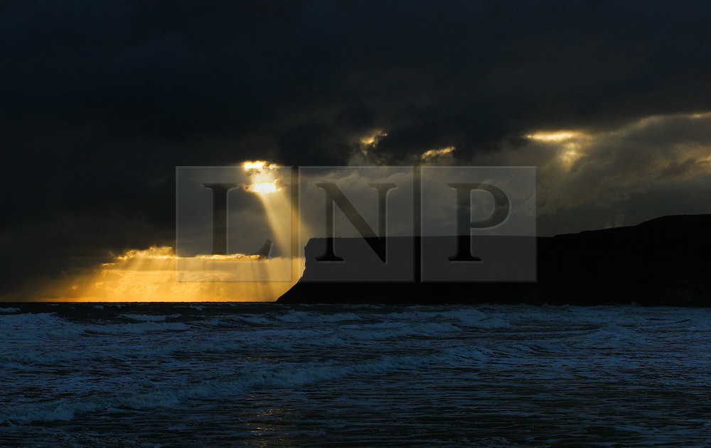 © Licensed to London News Pictures. 24/04/16<br /> Saltburn by the Sea, UK. <br /> <br /> Sunlight breaks through storm clouds off the coast at Saltburn by the Sea. Temperatures dropped over the weekend as cold air blew down from the arctic.  <br /> <br /> Photo credit : Ian Forsyth/LNP