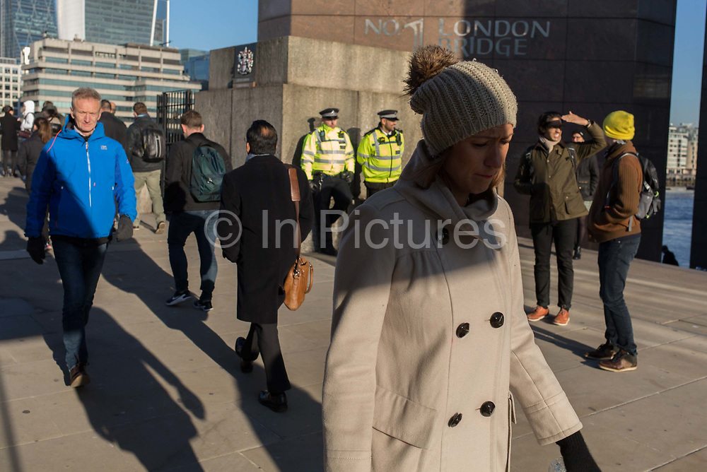 Three days after the killing of Jack Merritt, 25, and Saskia Jones, 23, by the convicted teorrorist Usman Khan at Fishmongers Hall on London Bridge, police officers make a high-profile presence to ensure the public feel safe, on 2nd December 2019, in London, England.