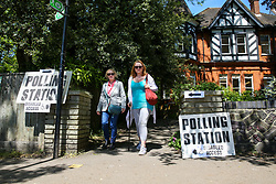 © Licensed to London News Pictures. 23/05/2019. London, UK. Voters leave Highgate Library polling station, Haringey in north London after casting their votes in the European Parliament elections. Earlier, police had lockdown the polling station and the surrounding area after the discovery of a suspect package. Voters and staff were evacuated from the building after the police cordoned off Raydon Street over the incident. Photo credit: Dinendra Haria/LNP