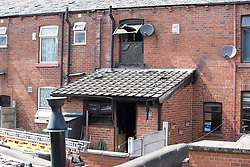 © Licensed to London News Pictures . 08/07/2017 . Bolton , UK . View of back of the house on Rosamond Street in Daubhill , where a fatal house fire burned through a mid-terrace house this morning (Saturday 8th July 2017) . Firefighters responded at 9am this morning (Saturday 8th July 2017) . A family of five are reported to have been inside at the time and there are understand to me multiple fatalities . Photo credit : Joel Goodman/LNP