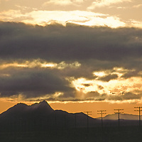 A cloud-filled sunset over Jarbidge Mountains.
