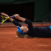 PARIS, FRANCE October 06. Danielle Collins of the United States falls to the ground as she celebrates her victory against Ons Jabeur of Tunisia in the fourth round of the singles competition on Court Philippe-Chatrier during the French Open Tennis Tournament at Roland Garros on October 6th 2020 in Paris, France. (Photo by Tim Clayton/Corbis via Getty Images)