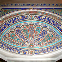 North Africa, Morocco, Marrakesh. Carved and painted stucco detail at El Bahia Palace.