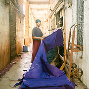 """The dye industry is one of the most polluting. In the """"New Cloth Market"""" - a British era fabric factory in Sadar district."""