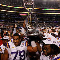 Jan 7, 2011; Arlington, TX, USA; LSU Tigers offensive tackle Joseph Barksdale (78) and  linebacker Kelvin Sheppard (11) hold up the championship trophy following a win over the Texas A&M Aggies in the 2011 Cotton Bowl at Cowboys Stadium. LSU defeated Texas A&M 41-24.  Mandatory Credit: Derick E. Hingle
