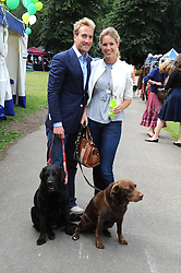 BEN & MARINA FOGLE and their dogs Inca and Maggie at the Macmillan Dog Day in aid of Macmillan Cancer Support held at the Royal Hospital Chelsea, London on 8th July 2008.<br />