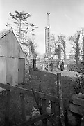 02/02/1963<br /> 02/02/1963<br /> 02 February 1963<br /> Ambassador Oil drilling site, Glengevlin, Dowra, Co. Cavan. In a farmyard setting the rig rises majestically as a symbol of hope in a barren mountainous countryside. (original caption)