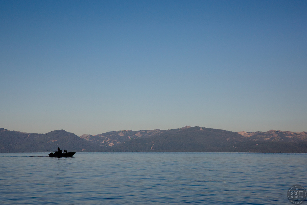 """""""Fishing Boat on Lake Tahoe"""" - This silhouetted fishing boat was photographed near Sand Harbor, Lake Tahoe."""