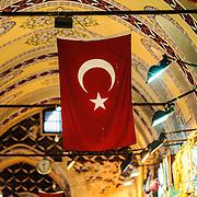 A Turkish flag hangs Inside Istanbul's historic Grand Bazaar