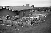 18/05/1966<br /> 05/18/1966<br /> 18 May 1966 <br /> I.C.I. House at Kilcroney, Co. Wicklow, for F.M. Cunneen of Imperial Chemical Industries (Ireland) Ltd., South Frederick Street, Dublin. View of workmen working on garage or shed by the patio.