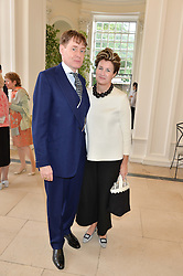NICK & ALEX FOULKES at a party to celebrate the 150th anniversary of Wartski held at The Orangery, Kensington Palace, London, on 19th May 2015.
