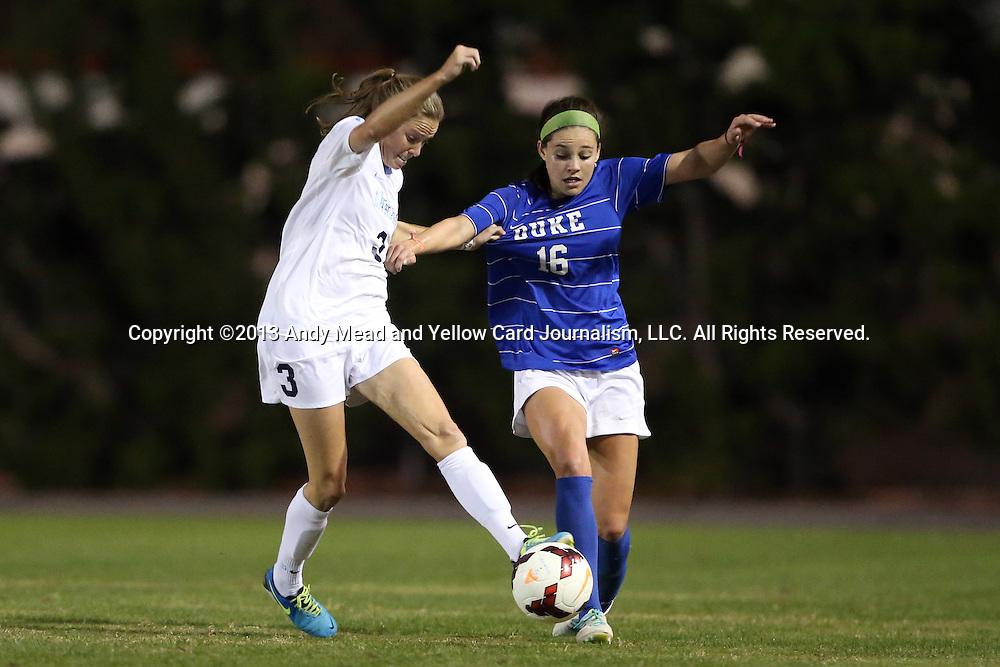 31 October 2013: Duke's Laura Weinberg (16) and North Carolina's Megan Brigman (3). The University of North Carolina Tar Heels hosted the Duke University Blue Devils at Fetzer Field in Chapel Hill, NC in a 2013 NCAA Division I Women's Soccer match. North Carolina won the game 3-0.