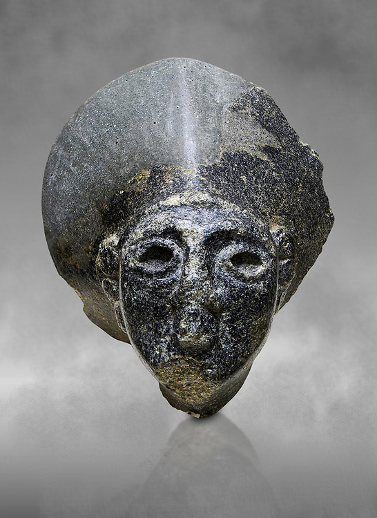 Hittite statue head of the Sun Goddess . Basalt, Hittie Period 1650 - 1450 BC. Hattusa Boğazkale. Çorum Archaeological Museum, Corum, Turkey. Against a grey bacground. .<br />  <br /> If you prefer to buy from our ALAMY STOCK LIBRARY page at https://www.alamy.com/portfolio/paul-williams-funkystock/hittite-art-antiquities.html  - Hattusa into the LOWER SEARCH WITHIN GALLERY box. Refine search by adding background colour, place,etc<br /> <br /> Visit our HITTITE PHOTO COLLECTIONS for more photos to download or buy as wall art prints https://funkystock.photoshelter.com/gallery-collection/The-Hittites-Art-Artefacts-Antiquities-Historic-Sites-Pictures-Images-of/C0000NUBSMhSc3Oo