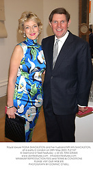 Royal lawyer FIONA SHACKLETON and her husband MR IAN SHACKLETON, at a party in London on 28th May 2003.PJZ 147