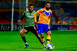 Stephen McLaughlin of Mansfield Town gets the ball away from Miles Welch-Hayes of Colchester United - Mandatory by-line: Ryan Crockett/JMP - 20/11/2020 - FOOTBALL - One Call Stadium - Mansfield, England - Mansfield Town v Colchester United - Sky Bet League Two